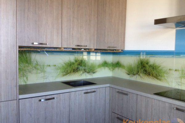 Foto van duinen op keuken spatwand